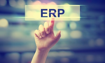 ERP - Enterprise Resource Planning concept with hand pressing a button on blurred abstract background